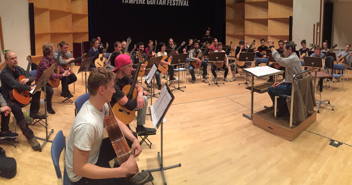 Leo Brouwer is conducting his work with Guitar Orchestra of Finland. Photo: Tomi Tolvanen